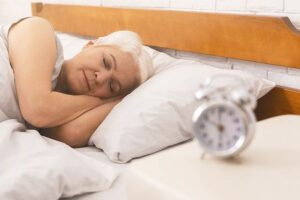 Bedtime. Senior Lady Sleeping In Her Bed Early In Morning, Panor